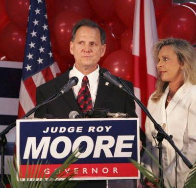 The Latest: White House remains noncommittal on Roy Moore