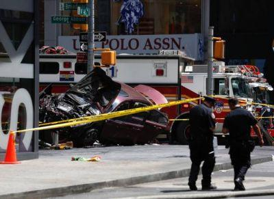 One dead, about 20 injured after car drives into crowd of pedestrians in New York's Times Square
