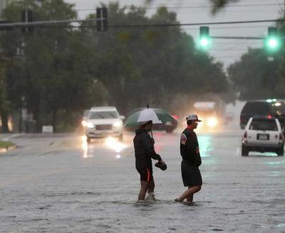 Rescues are underway as Imelda floods roads and homes in southeastern Texas