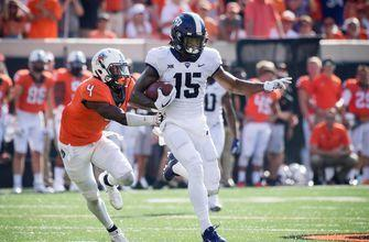 Kenny Hill and the No. 16 TCU Horned Frogs silence the No. 6 Oklahoma State Cowboys in 44-31 upset