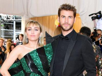 Miley Cyrus and Liam Hemsworth's Met Gala Looks Perfectly Represent Their Personalities