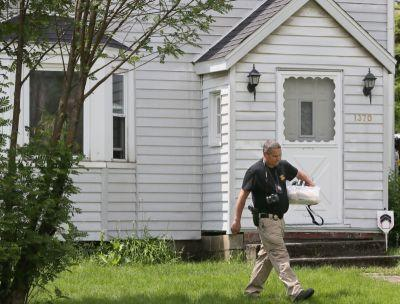 Authorities search two nearby houses in connection to Akron fire that killed seven, police say