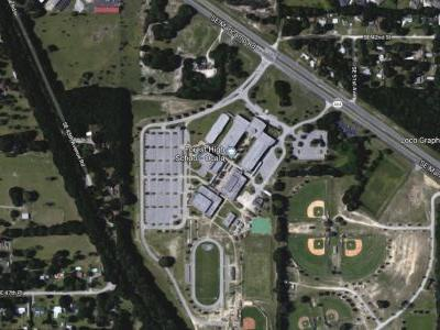 1 person injured, 1 in custody after shooting at Florida high school, authorities say