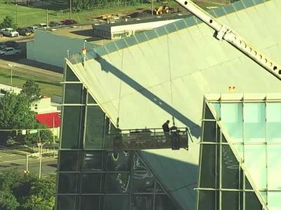VIDEO: 2 workers rescued from lift swinging out of control atop tallest building in OKC