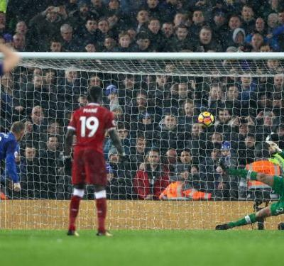 Liverpool 1 Everton 1: Late Rooney penalty secures unlikely derby draw