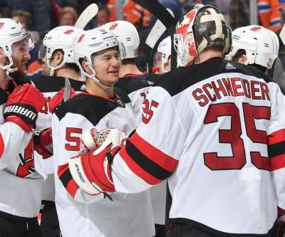 Devils use a balanced attack to snap seven-game skid