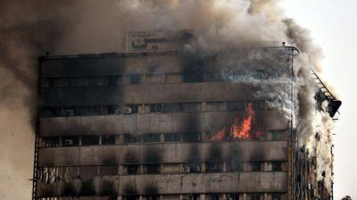 30 firefighters feared dead after blaze topples Tehran's oldest high-rise tower - Press TV