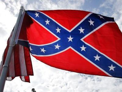 Marine Corps officially bans Confederate battle flag on military bases -including on bumper stickers and coffee mugs