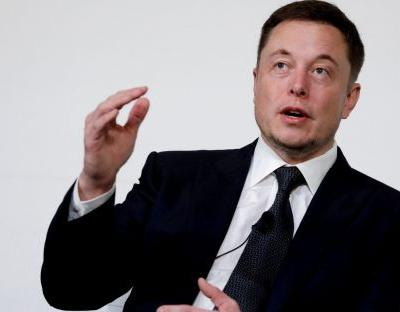 Who will be Elon Musk's first paying passenger on SpaceX moon mission?