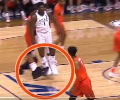 Syracuse's Frank Howard appears to try tripping up Zion Williamson