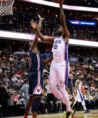 Beal scores 14 straight points, Wizards beat 76ers 123-106