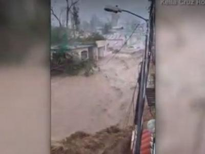 Video shows flood waters from Hurricane Maria rush down street