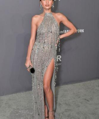 A glowing Kelsey Merritt in GEORGES HOBEIKA at the amFAR New