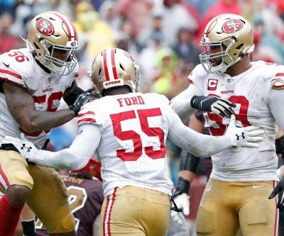 49ers shut out Redskins in downpour to remain undefeated