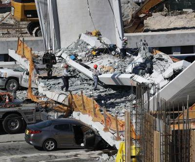 Video captures the deadly moment a pedestrian bridge collapsed