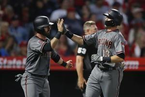 Goldschmidt's HR, Dyson's catch lead Arizona past Halos, 7-4