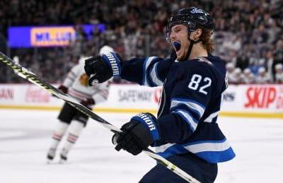 Nathan Beaulieu, Jets down Blackhawks to snap 2-game slide