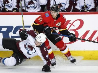Flames score five goals in the third in thrilling comeback over Avs