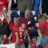 You'll Bite ALL Your Nails Watching This Dad Catch a Homerun While Holding His Baby