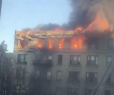 Fire rages on top floor of Harlem apartment building