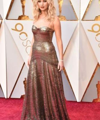 Jennifer Lawrence Kills The Red Carpet In A Gold Dior GownSee