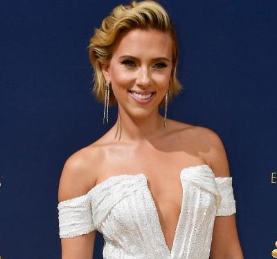 Scarlett Johansson attended the Emmys with host Colin Jost -and she served up some major movie glamour