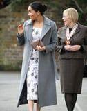 Meghan's Floral Midi Dress Will Have You Pondering If You're Brave Enough For Bare Legs in Winter