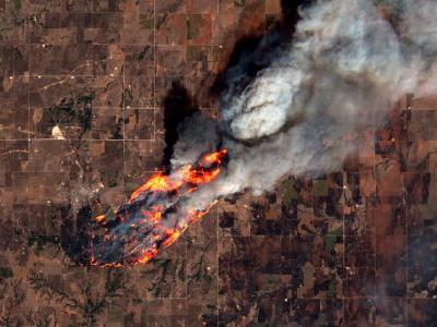 A fire in the US midwest is so big you can see it from space - two people have been killed in the blaze so far