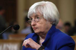 Fed boosts benchmark rate for third time this year