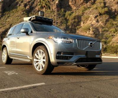 Uber halts self-driving tests after pedestrian killed in Arizona