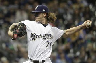 Guerra deals, Thames homers to lift Brewers over Reds 2-0