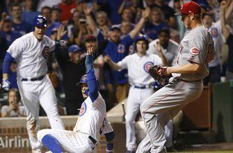 Rizzo slams, Cubs top Reds on wild pitch, 7-6