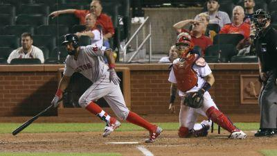 Young breaks tie in 13th, Red Sox rally past Cardinals