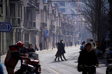 China COVID-19 cases surge to over 10-month high; travel discouraged