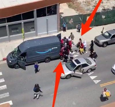 A video shows looters throwing rocks and raiding an Amazon delivery van during George Floyd protests in Los Angeles