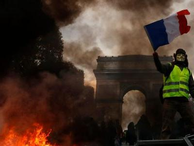 France is reportedly freezing a divisive fuel tax after days of violent protest from Yellow Vest movement that killed 3