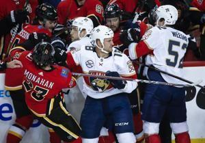 Frolik rallies streaking Flames to 4-3 win over Panthers