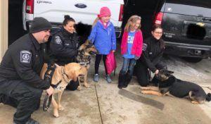 Dog-Loving Little Girl Fighting Brain Tumor Gets a Visit from Almost 40 Police K9s!