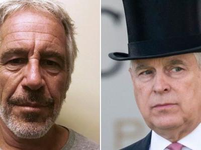 Prince Andrew says the picture of him with his hand around Virginia Roberts' waist might not be real