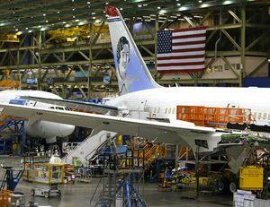 Boeing beats 2Q profit forecasts, raises full-year outlook