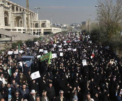 Iran hard-liners rally as new protests challenge government