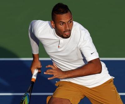 Nick Kyrgios continues feud with chair umpire, smashes two rackets in hallway beneath stands