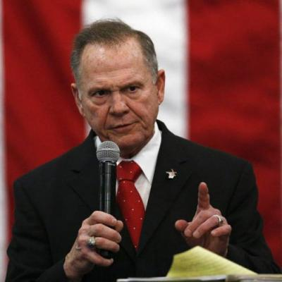 The Latest: Jones met with cheers as he casts his ballot