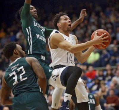 University of Akron men's basketball: Zips overcome poor free-throw shooting, stretch home winning streak to 27 with 70-63 win over Eastern Michigan