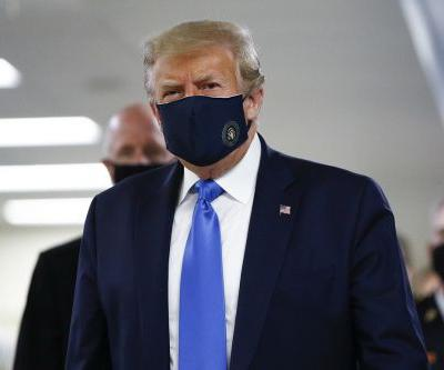 Trump wears mask in public for first time during visit to Walter Reed