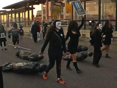 Demonstrators Pull Body Bags, Carry Tombstones In 2nd Night Of Protests Over Derek Chauvin's Release
