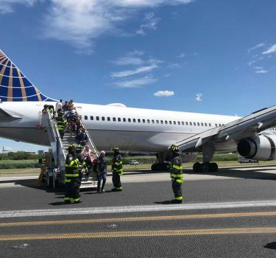 Plane landing at Newark airport blows tires, skids on runway