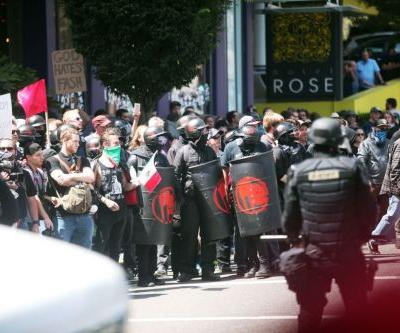 Police deploy flash-bangs to disperse crowds in Portland, Oregon, say projectiles thrown