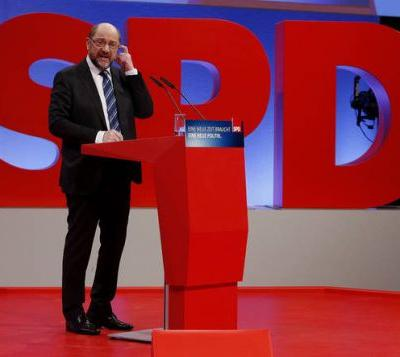The Latest: German Social Dems vote to enter coalition talks