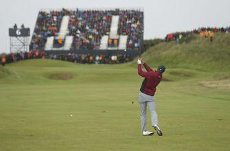 The Latest: Spieth tees off as Open leader on low score day